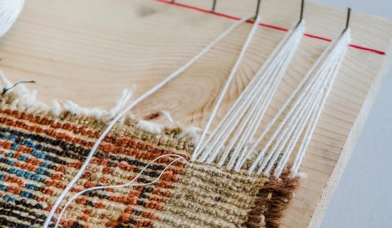 ניקוי ותיקון שטיחים (פרנזים)